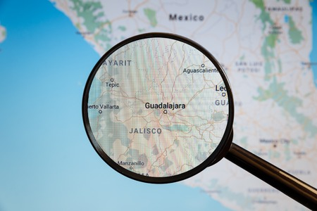 Guadalajara, Mexico. Political map. The city on the monitor screen through a magnifying glass. Stockfoto