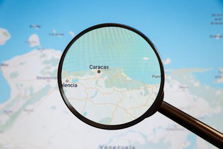 Caracas, Venezuela. Political map. The city on the monitor screen through a magnifying glass Stockfoto