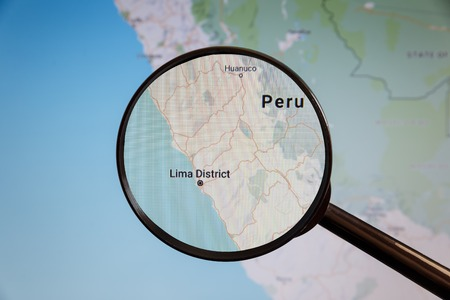 Lima, Peru. Political map. The city on the monitor screen through a magnifying glass.