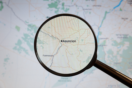 Asuncion, Paraguay. Political map. The city on the monitor screen through a magnifying glass Stockfoto