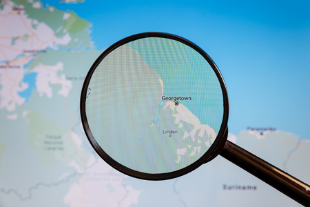 Georgetown, Guyana. Political map. The city on the monitor screen through a magnifying glass Stockfoto