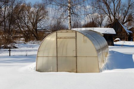 greenhouse in winter, Small greenhouse with a metal frame covered with polycarbonate.