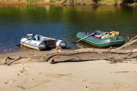 two rubber boats, rubber boats on the sand by the river
