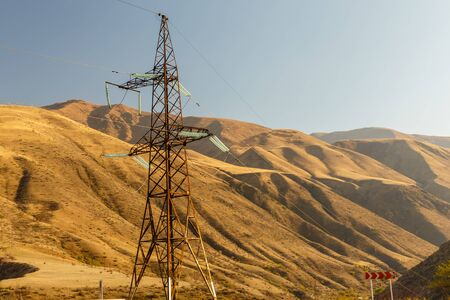 high voltage power transmission pylon in the mountains, high voltage post Mountain landscape