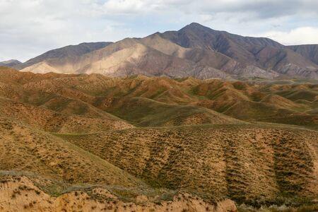 mountains near the Toktogul Reservoir, Toktogul district of the Jalal-Abad region of Kyrgyzstan Фото со стока