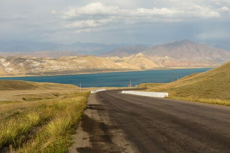 road to Toktogul reservoir, reservoir in the territory of the Toktogul district of the Jalal-Abad region of Kyrgyzstan.