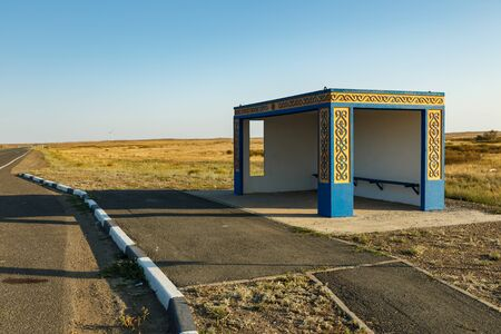 empty bus stop on the road, waiting place for the bus, Kazakhstan