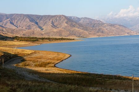 Toktogul Reservoir in the territory of the Toktogul district of the Jalal-Abad region of Kyrgyzstan.