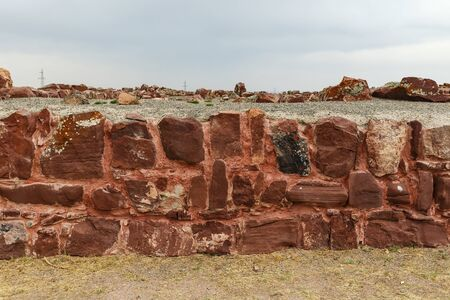 Akyrtas Palace Complex. Kazakhstan. red sandstone wall.