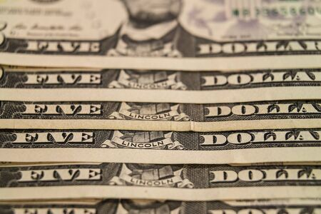 background from paper money. five United States dollars. Фото со стока