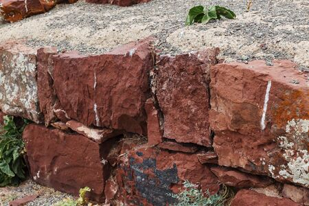 ruined ancient wall in Akyrtas Palace Complex. Kazakhstan. red sandstone wall.
