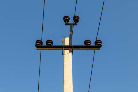 High voltage power line. Electric power line support and wires. blue sky.