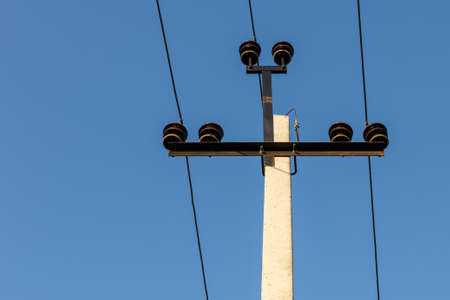 High voltage Electric power line support and wires. blue sky.