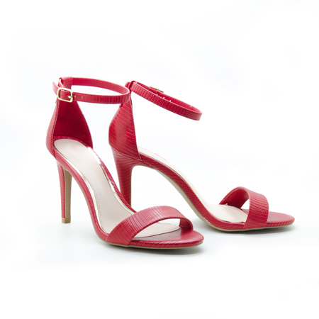 A pair of beautiful shape red high ankle strap heels  isolate on white background.