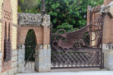 Mythological dragon in the garden of the Hesperides, pavilions entrance to Finca Guell in Barcelona
