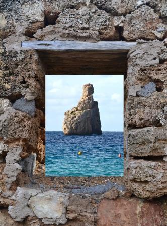 View Ibiza Cala Benirras in through a window