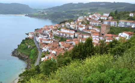 View of Lastres on the asturian coast - Typical fishing village in Spain photo