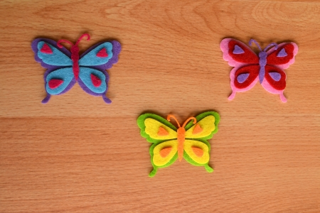 Colorful butterflies on rustic wooden background photo