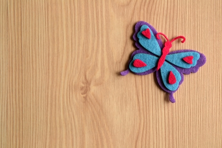 Colorful butterfly on rustic wooden background photo