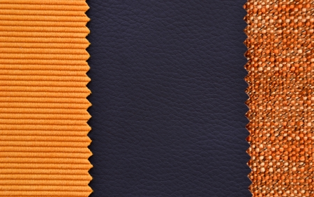Corduroy and leather texture in black and orange colors photo