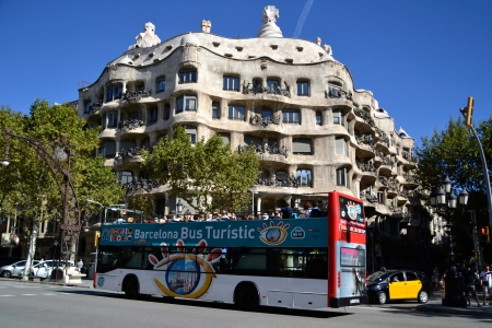 BARCELONA, SPAIN - SEPTEMBER 29  Tourist bus in Barcelona, Spain on September 29, 2013  Barcelona Bus Turistic is an official touristic bus service that shows the city with an audio guide