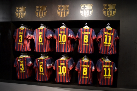 BARCELONA, SPAIN - OCTOBER 26  FC Barcelona shirts in FC Barcelona Shop, Spain on October 26, 2013  FC Barcelona s Store is the official store of shirts, balls and merchandising of the team