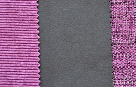 Corduroy and leather texture in black and purple colors photo
