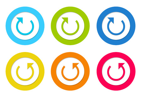 Colorful rounded icons with arrow symbol in blue, green, yellow, orange and red colors photo