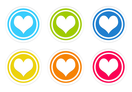 Set of rounded colorful icons with heart symbol in blue, green, yellow, red and orange colors