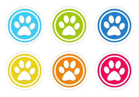 青、緑、黄色、赤、オレンジ色でペットの足跡と丸いカラフルなアイコンのセット