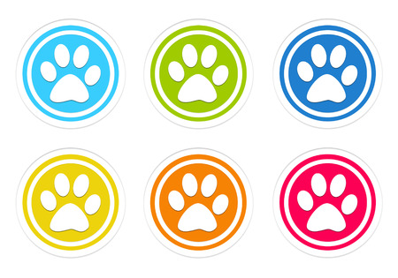Set of rounded colorful icons with pet footprints in blue, green, yellow, red and orange color Standard-Bild