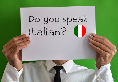 Businessman showing a sheet with text Do you speak Italian photo