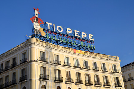 to pepe: MADRID, SPAIN - DECEMBER 24: Tio Pepe advertisement in Madrid, Spain on December 24, 2014. It is located at the roof of a building in Puerta del Sol and it is a famous sign in Madrid.