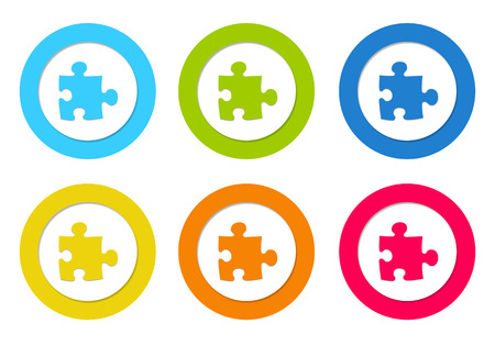 Colorful rounded icons with puzzle symbol in blue, green, yellow, orange and red colors photo