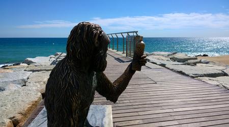 ruiz: BADALONA, SPAIN - SEPTEMBER 18 Monkey Sculpture in Badalona, Spain on September 18, 2015 Sculpture designed by Susana Ruiz and represents the monkey bottle label brand of Anis del Mono factory