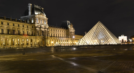 louvre pyramid: PARIS, FRANCE - OCTOBER 20: Louvre Pyramid at night in Paris, France on October 20, 2013. The Louvre is the biggest Museum in Paris and one of the major tourist attractions.