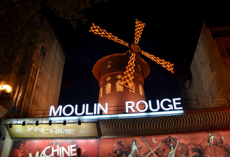 moulin: PARIS, FRANCE - OCTOBER 19: Moulin Rouge in Paris, France on October 19, 2013. Moulin Rouge was built in 1889 and its one of the most famous cabarets in Europe.