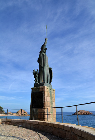 minerva: TOSSA DE MAR, SPAIN - OCTOBER 16: Monument to Minerva in Tossa de Mar, Spain on October 16, 2014. Sculpture designed by Frederic Mares i Deulovol in 1974.