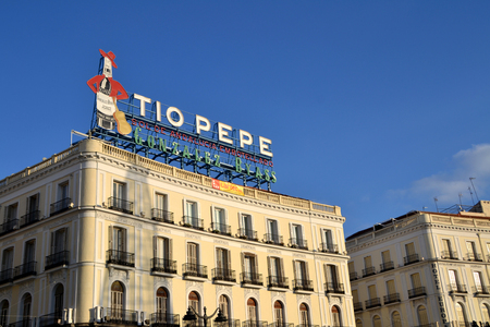 pepe: MADRID, SPAIN - DECEMBER 24: Tio Pepe advertisement in Madrid, Spain on December 24, 2014. It is located at the roof of a building in Puerta del Sol and it is a famous sign in Madrid.