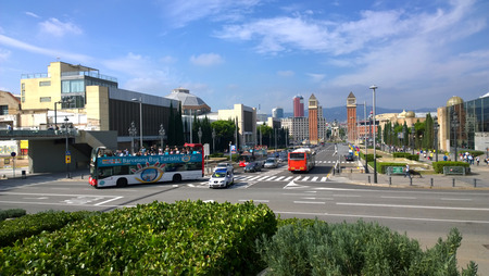 turistic: BARCELONA, SPAIN - OCTOBER 11: Tourist bus in Montjuic district in Barcelona, Spain on October 11, 2015. Barcelona Bus Turistic is an official touristic bus service that shows the city.