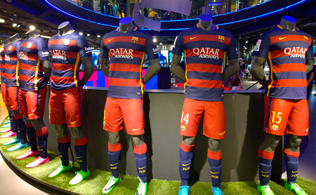 futbol: BARCELONA, SPAIN - OCTOBER 13: FC Barcelona kits in FC Barcelona Shop, Spain on October 13, 2015 FC Barcelona Store is the official store of shirts, balls and merchandising of the team Editorial