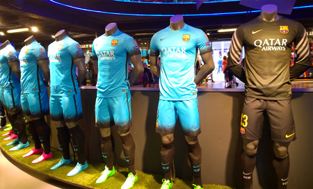 iniesta: BARCELONA, SPAIN - OCTOBER 13: FC Barcelona kits in FC Barcelona Shop, Spain on October 13, 2015 FC Barcelona Store is the official store of shirts, balls and merchandising of the team Editorial