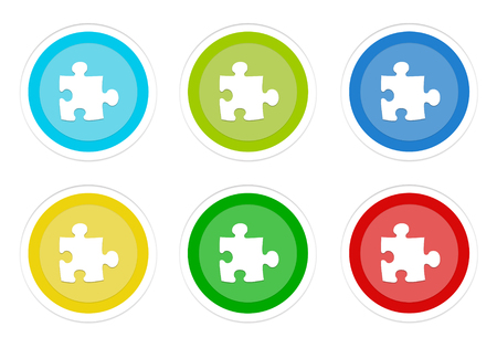 Set of rounded colorful buttons with puzzle symbol in blue, green, yellow, cyan and red colors