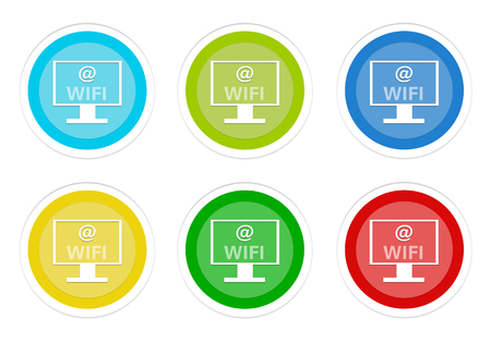 Set of rounded colorful buttons with computer display and wifi symbol in blue, green, yellow, cyan and red colors
