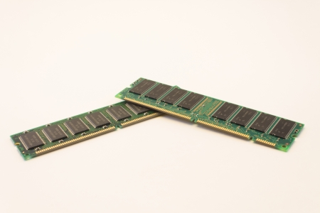 Two sticks of DDR computer memory  also known as Random Access Memory or RAM  stacked on top of each other