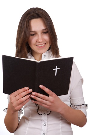 A young girl holding a bible in her hands Stok Fotoğraf
