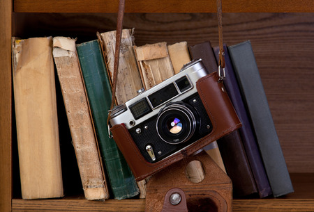 Vintage camera and old books on a shelf