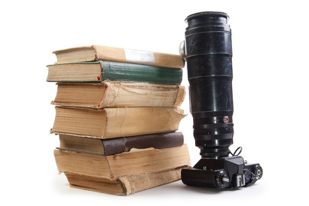 nonworking: Vintage camera and old books on a white background. Isolated