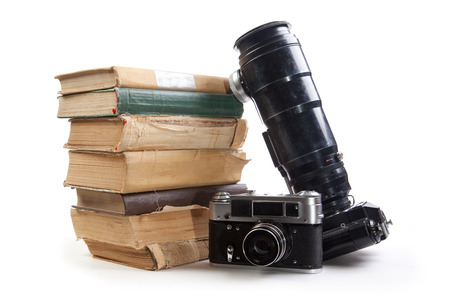 Vintage camera and old books on a white background. Isolated