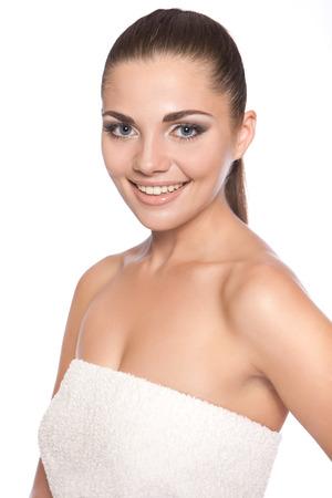 Spa salon. Beautiful girl in a towel after bath
